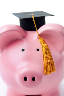 Finance and Savings for University Education Piggy Bank on Books